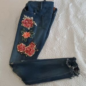 Express distressed jeans with floral decals